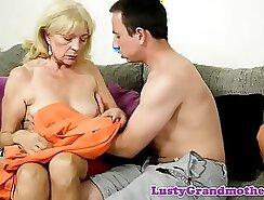 Beautiful grandmother playing with cocks