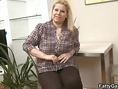 Blonde UNCUT MILF with massive tits in porn theater