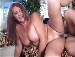 Busty mature sweetie bounces her shaft on the sofa