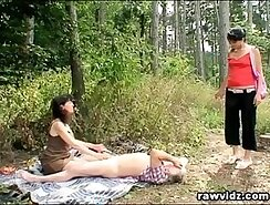 Amateur teen couple plays with fishnet bodysuit outdoors