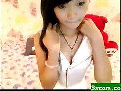 Asian teen masturbating her pussy on cam