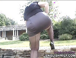 Black-haired slut in pantyhose flashes ass and sucks producer dick outdoors