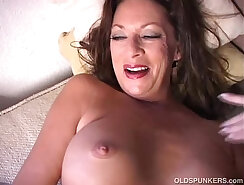 Cougar chick strips and plays with her pussy