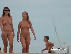 Aina West sits on the beach naked